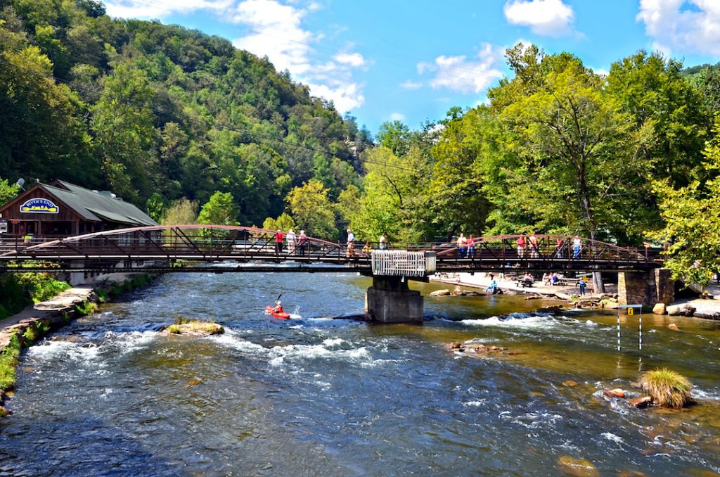 BRYSON CITY, NC, USA - SEPT 9: River's End Restaurant and bridge over the Nantahala River, Sept, 9, 2012. A popular tourist area for hiking and water sports in the Smoky Mountains.